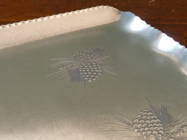 Aluminium tray with impressed pine cone design