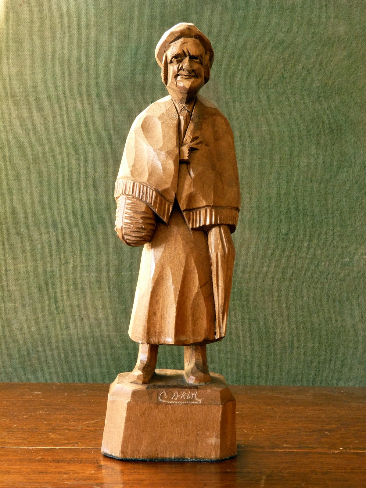 Caron carved wood figure of an old woman