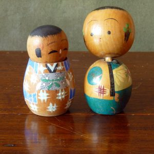 A pair of vintage wooden bobble head Kokeshi Dolls