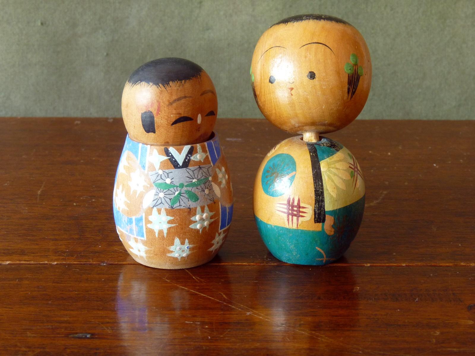 A pair of vintage wooden bobble head Kokeshi Dolls