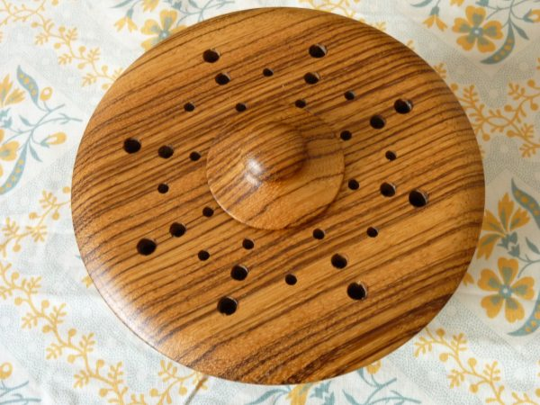 Turned wood pot pourri bowl with contrasting grain