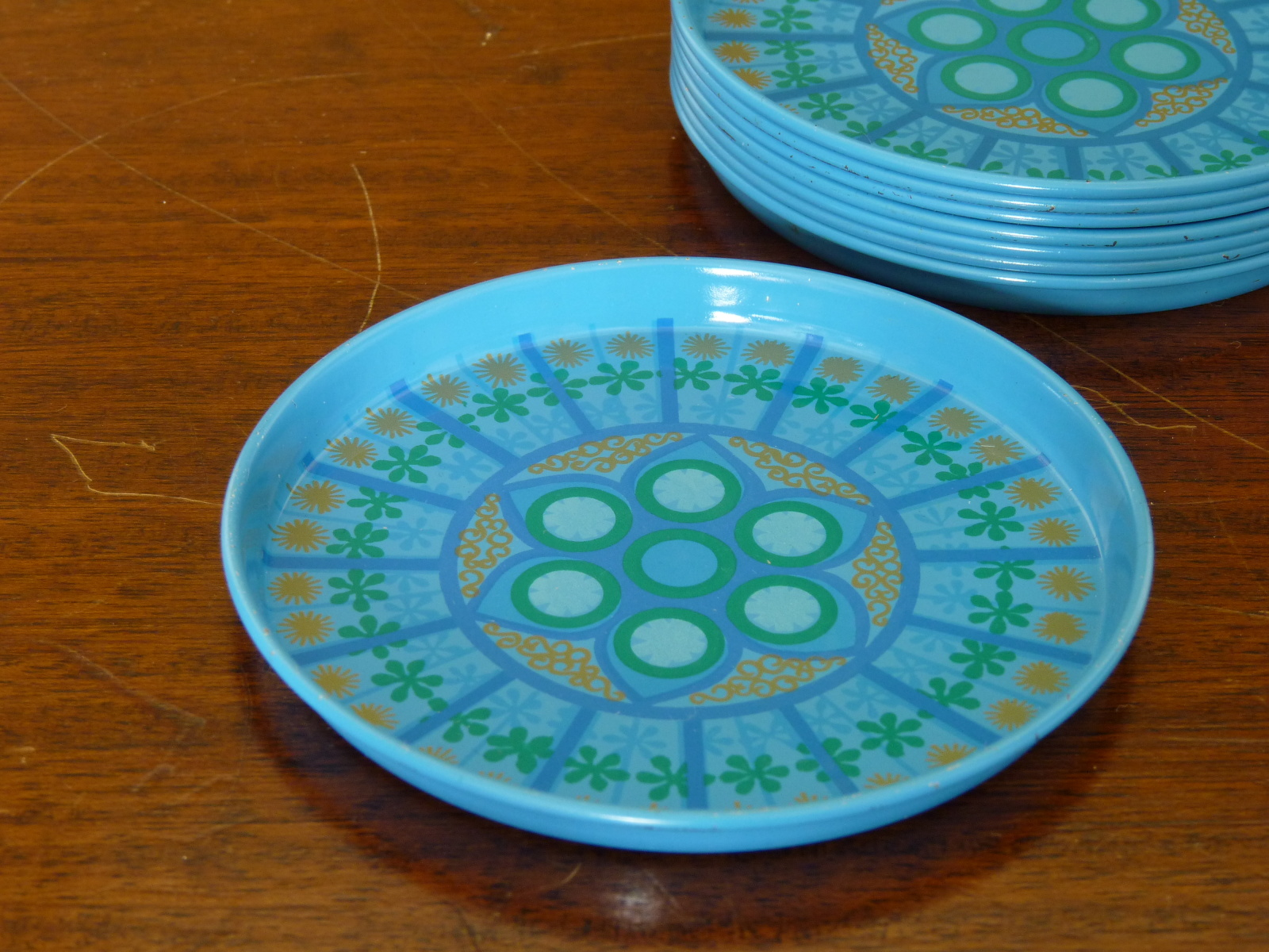 Eight Worcesterware Blue and Gold Metal Drinks Coasters
